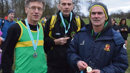 The M60 medallists from Hunts AC are, from the left, Richard Holland, Shane Hunt and Derek Darnell.