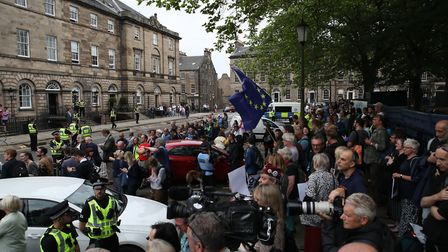 Crowds outside Bute House wait for the arrival of Prime Minister Boris Johnson for his meeting with