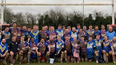 The two teams gather after the charity rugby game at Verulamians Rugby Club.