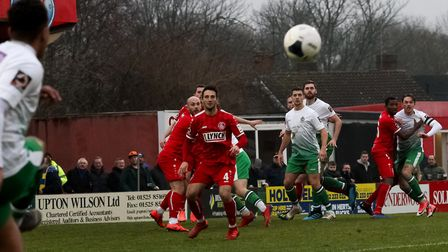 Michael Clark, James Kaloczi and Tom Bender look to get on the end of a Zane Banton free-kick for St