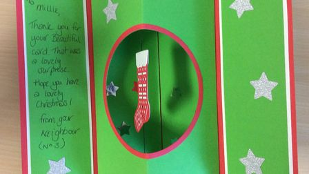 A thank you card from a neighbour who recived one of the Year 3 student's homemade Christmas cards P