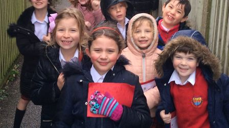 Children deliver their handmade Christmas cards to their neighbours undeterred by the rain Picture: