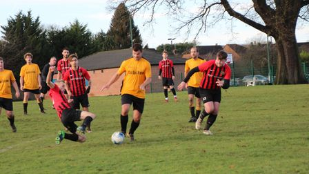 Marshalswick Rovers attempt to break through the Forza Watford defence. Picture: BRIAN HUBBALL