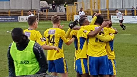 Jefferson Louis is mobbed after scoring his first St Albans City goal against Hungerford Town.