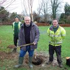 Councillor Chris White, the Council Leader and Portfolio Holder for Climate and Environment, helps w