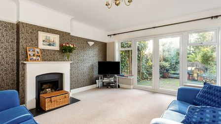 Doors from the living room also lead out to the garden. Picture: John Curtis