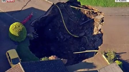 Sky News aerial footage of the sinkhole in Fontmell Close, St Albans.