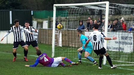 Goalmouth action from the New Year's Day clash between St Ives Town and AFC Rushden & Diamonds. Pict