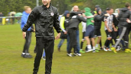 Ricky Marheineke celebrates leading St Ives Town to promotion in 2016 - the goal is survival this se