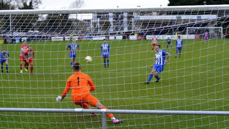 Craig Daniel scores from the penalty spot for Eynesbury Rovers against Leighton Town. Picture: DUNCA