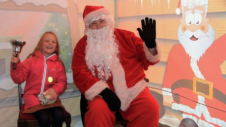 Freya Clarke on the with Santa at the Royston Christmas Rudolph trail. Picture: Clive Porter