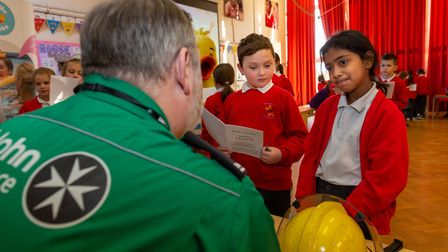 Pupils speak to visitors about their different professions at a Dream Big day at Margaret Wix Primar