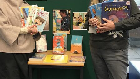 Stacey Turner and library manager Sally King highlight the Reading Well for Children list at St Alba