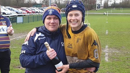 Laura Gott receives her player of the match award from OA Saints club captain Julia Holmes. Picture: