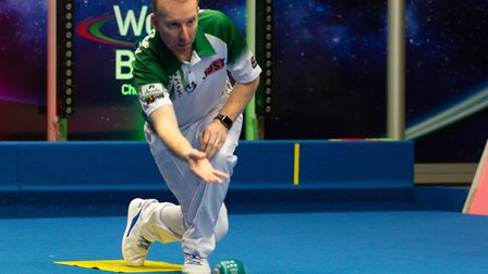 Nick Brett in action during the Mixed Pairs final at the World Indoor Championships earlier this wee