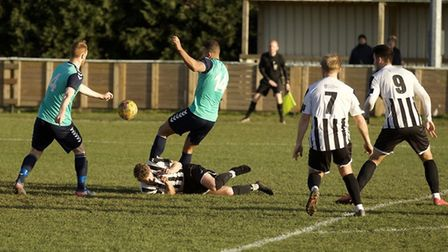 George Bailey hits the deck and earns St Ives Town a penalty against Rushall Olympic. Picture: LOUIS