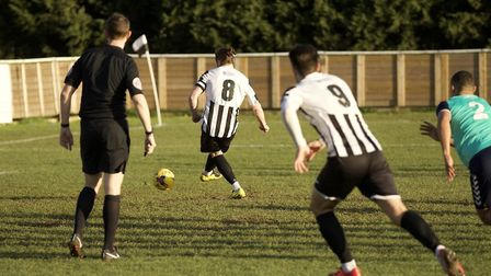 Robbie Parker scores from the penalty spot for St Ives Town against Rushall Olympic. Picture: LOUISE