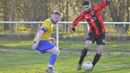 Action from Huntingdon Town's defeat to Bugbrooke last Saturday. Picture: DUNCAN LAMONT