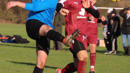 Plough & Harrow player shoot for goal under pressure from an AFC London Road player. Picture: BRIAN