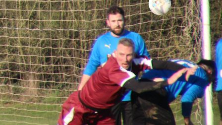 AFC London Road''s Eamon Rogers in the thick of the action from a corner. Picture: BRIAN HUBBALL