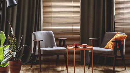 Some homeowners do the double, with curtains and blinds. Picture: iStock/PA
