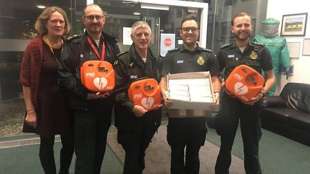 (L – R) Lorna Hayes (head of tactical operations and community response) with the defibrillators and
