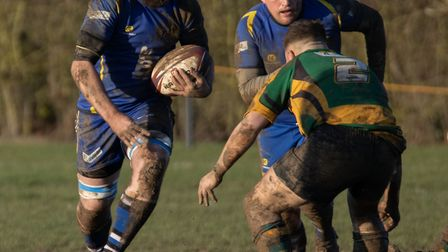 Shaun Mundy on the charge for St Ives against Bugbrooke with Sam Smith in support. Picture: PAUL COX