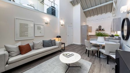 An open plan living area at Hansell House, with mezzanine bedroom above. Picture: Taylor Wimpey