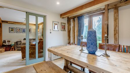 The bright dining area provides views of the garden. Picture: Fine & Country
