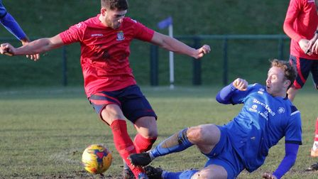 St Neots Town player Panny Boxer is on the receiving end of a nasty tackle during their defeat at AF
