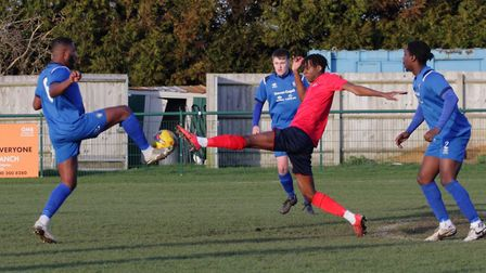 St Neots Town man Prince Mutswunguma at full stretch during their defeat to AFC Dunstable. Picture: