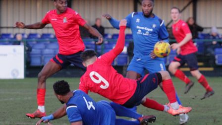 St Neots Town striker Joe Neal is sent tumbling during the Southern League Division One Central clas
