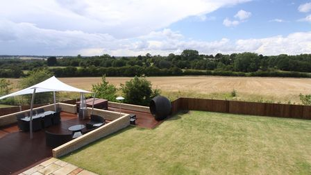 An extensive terrace area to the rear of the property provides unspoilt views over farmland and Harp