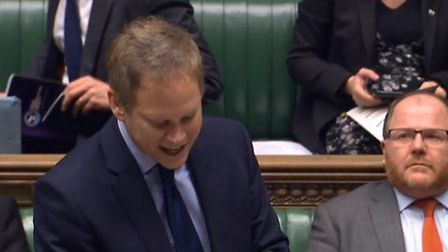 Transport Secretary Grant Shapp speaking at the House of Commons.