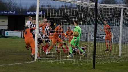 The goalmouth scramble in which Matt Foy claimed a last-gasp winner for St Ives Town at Coalville To