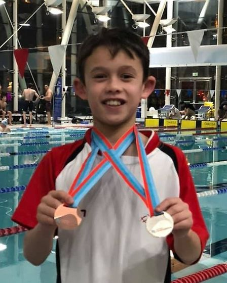 Huntingdon Piranhas talent Kian Lee shows off his Cambridgeshire County Championships medals. Pictur