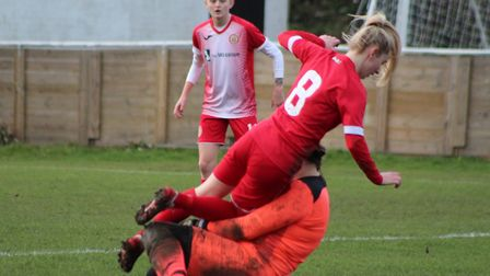St Ives Town Ladies goalkeeper Kira Markwell stops a Harlow Town attack last Sunday. Picture: GARY R