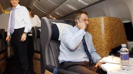 Prime Minister Tony Blair, watched by his Director of Communications and Strategy, Alastair Campbell