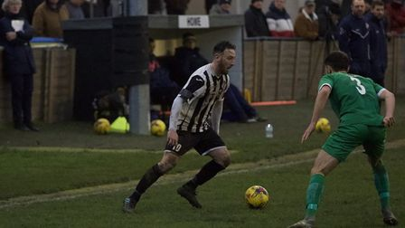 Joe Curtis in action for St Ives Town during the defeat to Biggleswade Town last Saturday. Picture: