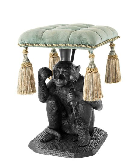 Eichholtz Monkey Stool features a cotton seat above an aluminium crouched monkey strikingly black fi