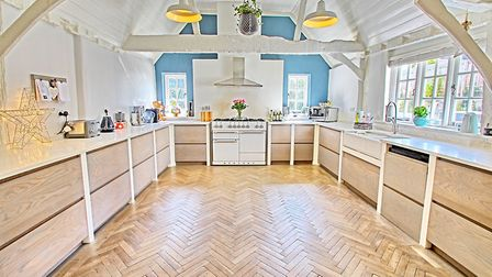 The farmhouse kitchen has vaulted ceilings and underfloor heating. Picture: Jonathan Hunt
