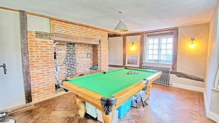 One of the four reception room is currently being used as a games room. Picture: Jonathan Hunt