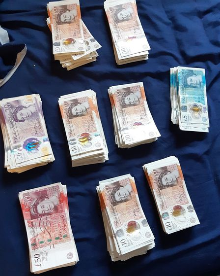 Cash seized by police as part of a warrant in Bassingbourn. Picture: Cambs police