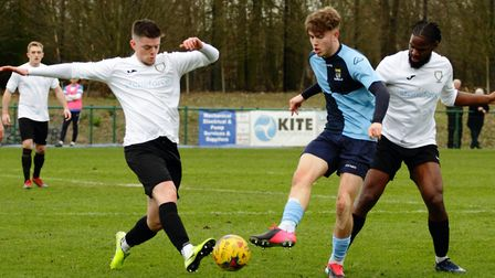 St Neots Town youngster Lewis Simper is surrounded during their clash with table-topping Berkhamsted