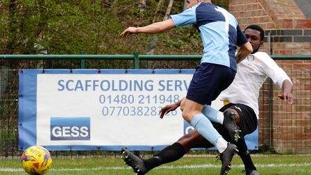 Joe Sutton battles for the ball during St Neots Town's defeat to Berkhamsted. Picture: DAVID R. W. R