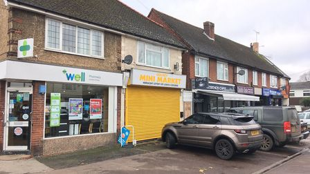 A cafe, pharmacy and barbers are some of the amenities on offer on this London Colney High Street pa