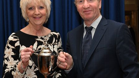 Peter Dixon presents the cup to Christine Taylor