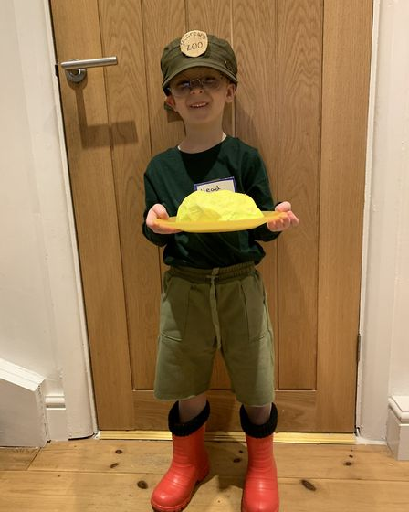 World Book Day 2020: Logan Mellor, four, as little Bob McGrew from Poo in the Zoo, holding a pile of