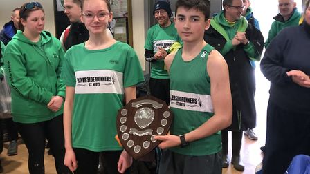 Rhian Bailey and Mike Sells with the runners-up shield which Riverside Runners won at junior level i