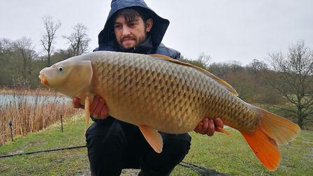 Valius Paskonis shows off his big common carp. Picture: SUBMITTED